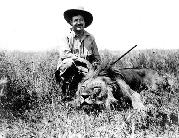 Hemingway with lion on safari.