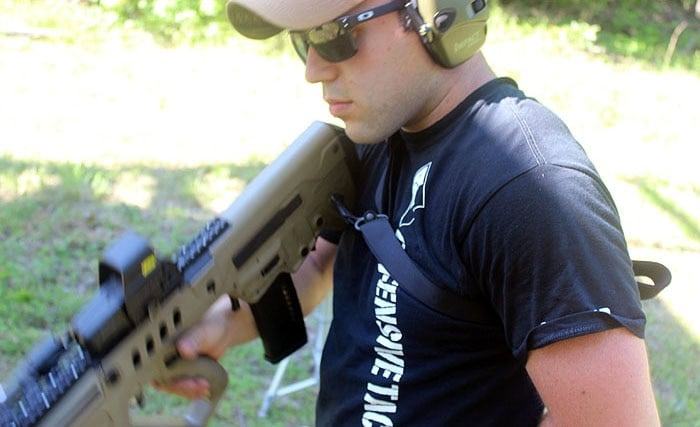 male shooter with magpul sling on rifle