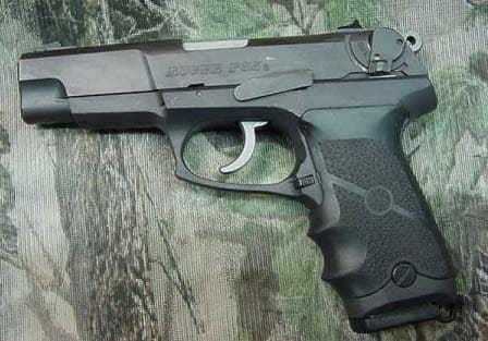 Ruger P85 with aftermarket grips.