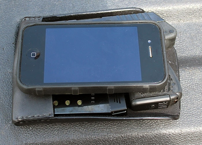 iphone 4 sitting on top of recluse holster