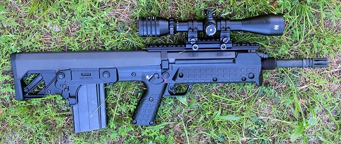 ke tec rfb with scope sitting on grass
