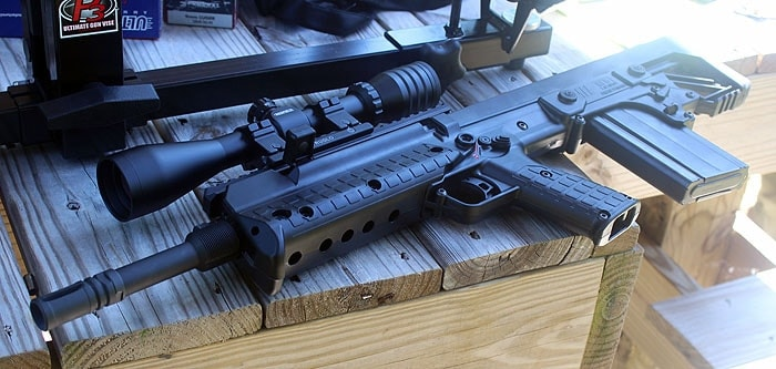 kel tec rfb with scope sitting on table