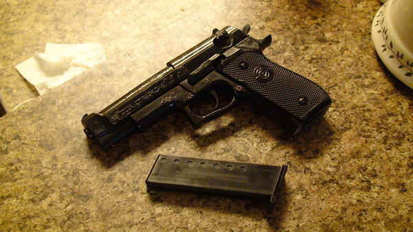 The toy gun used to chase off intruder.