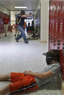 Volunteers spent 53 hours training for school shooting scenarios. (Photo credit: AP)