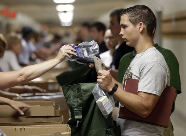 Cadet Sumner Ogrydziak collects clothing on his first day at West Point. (Photo credit: Associated Press)