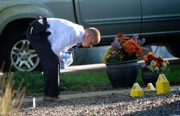 Investigators work to determine what exactly occurred Sunday night when a Denver resident shot a man trying to get into his home. (Photo credit: The Denver Post)