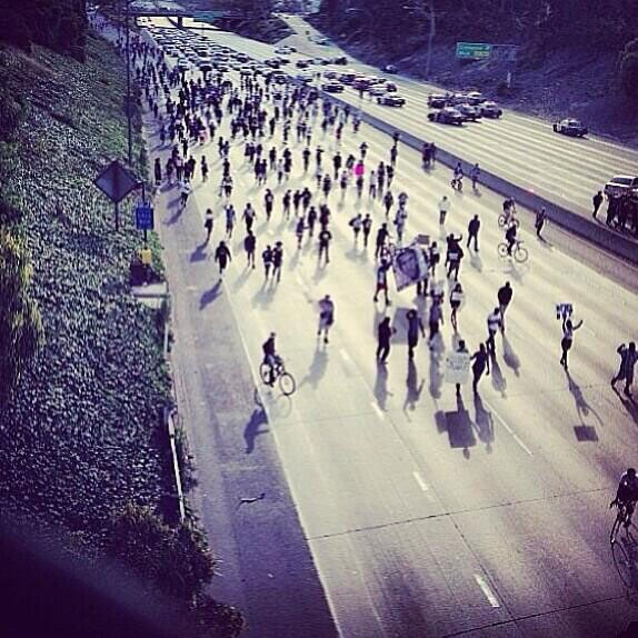 Protesters block the 10 Freeway in Los Angeles