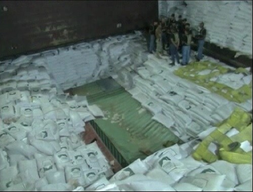 Panamanian Authorities Investigating the ships hull that wall full of sugar and military hardware. (Photo Credit: Time)