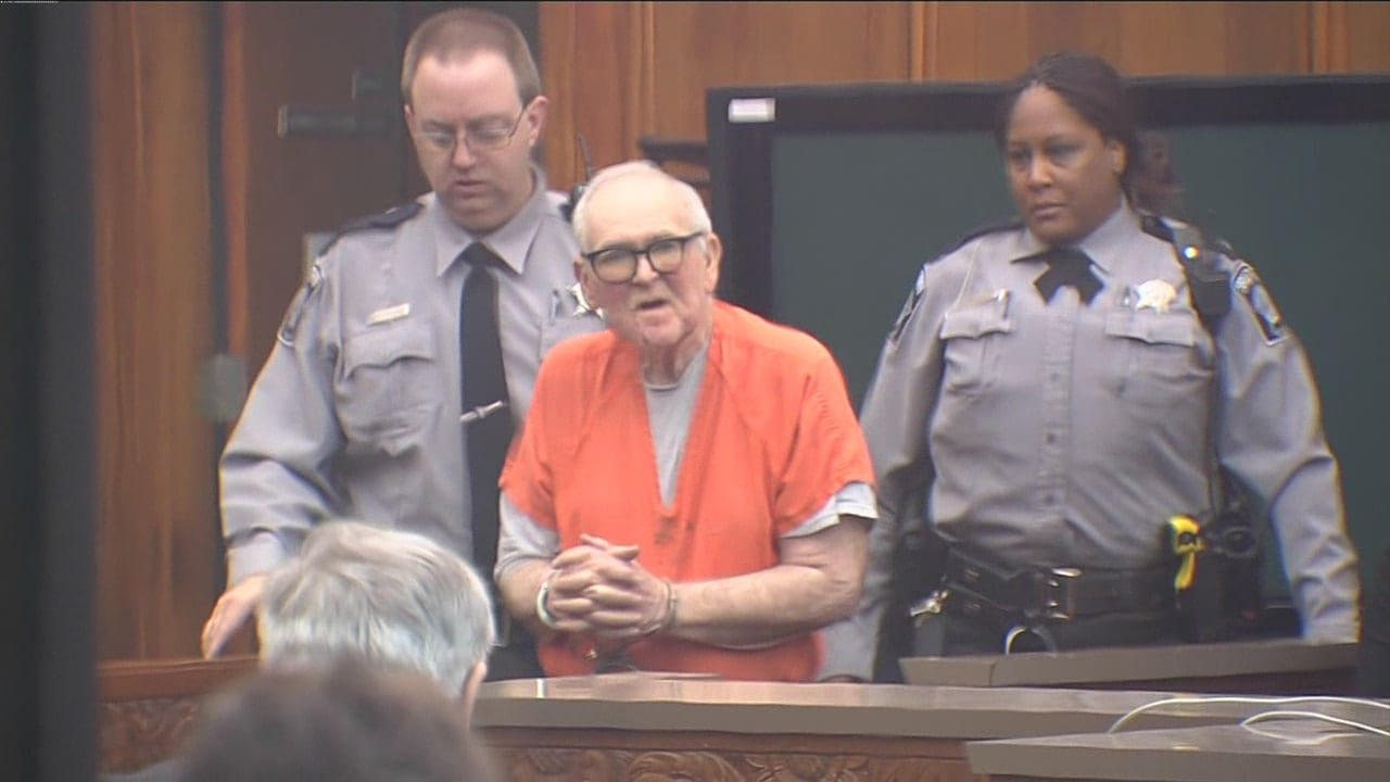 Unconfirmed reports say John Spooner, center, has adjusted well in jail.