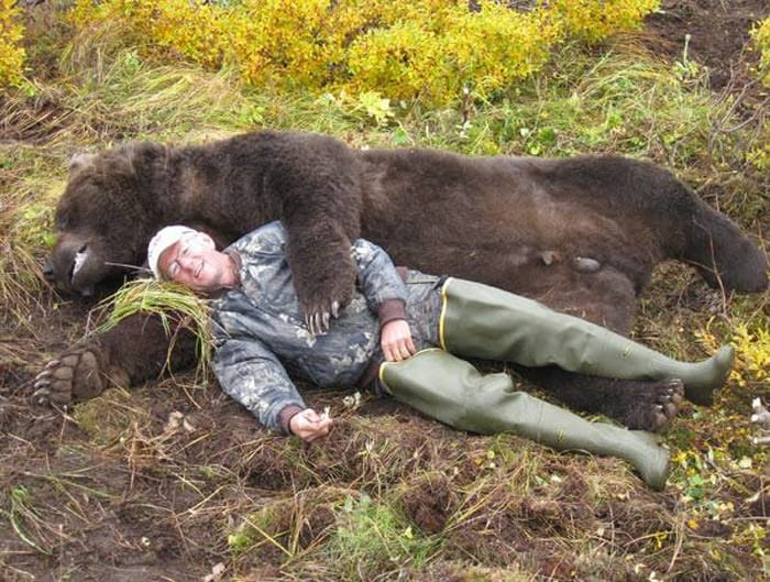 larry potterield laying next to dead bear