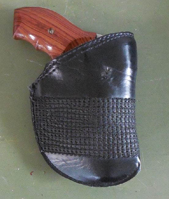 Model 649 in simple leather pocket holster.