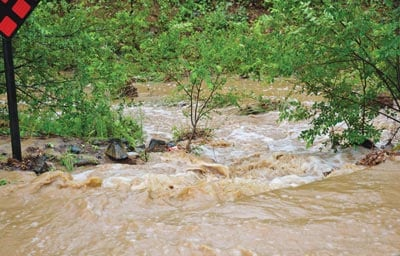 Water runs unchecked in Miller Creek near Dougherty Street in Prescott, Arizona. (Photo credit: The Daily Courier)