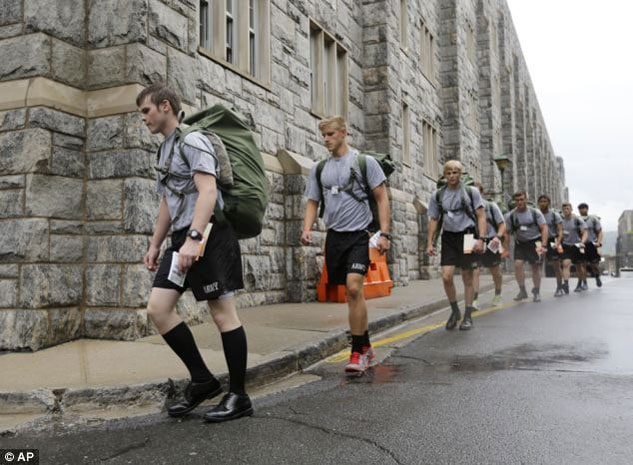 The boys march with other cadets on reception Day. (Photo credit: Associated Press)