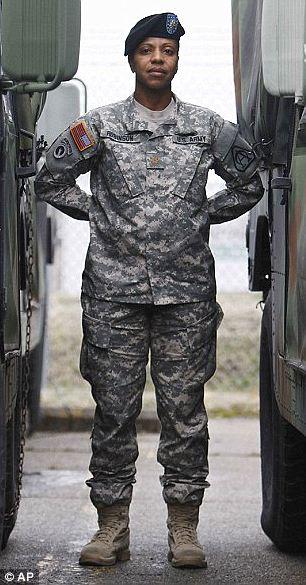 Major Sequana Robinson models a new women's combat uniform. (Source: AP)