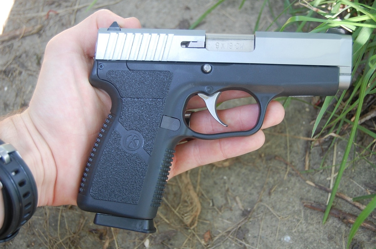 kahr cw9 placed in hand outdoors