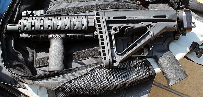 ar on top of gun bag