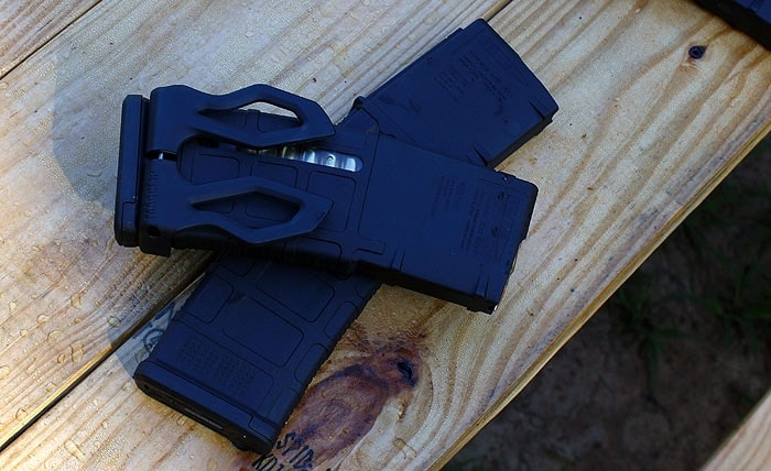 magpul magazines sitting on top of eachother on wood table