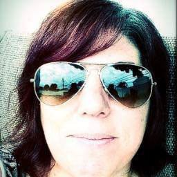 What is Michele Catalano hiding behind her dark shades? (Photo credit: Facebook)