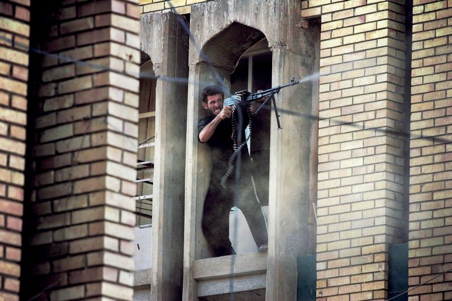 Najaf August 22, 2004 A militiaman loyal to Shi'ite cleric Muq