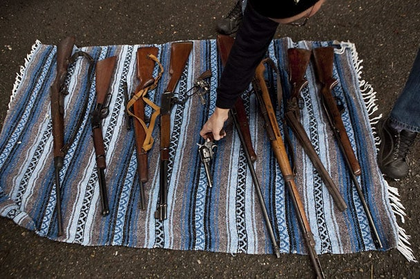 Apparently this wasn't Laigaie's only dealing with the local police. Him and two friends showed up near a gun buyback in Seattle in January and purchased a nice array of firearms from residents looking to give up their guns. (Photo credit: The Seattle Times)