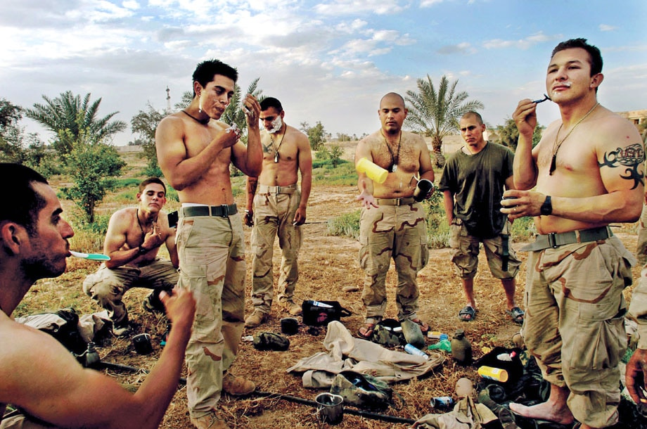 April 15, 2003 United States Marines take a break to shave in fr