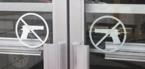 Signs are posted at the entrances of the mall to ensure that no firearms are brought on the premises. (Photo credit: WREG)