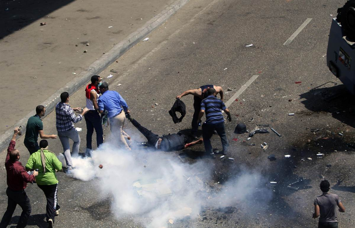 Morsi protestors dragged the mutilated bodies of the police officers.