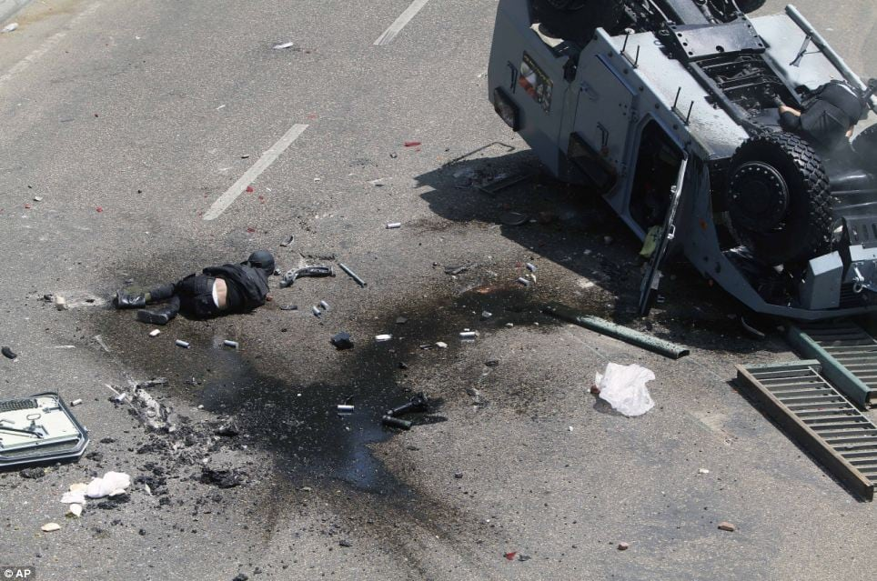 It is unknown how many police officers were inside the armored van, but some reports say five were killed in the fall.