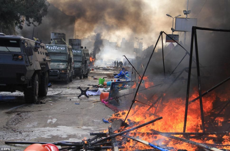 Much of Cairo was set ablaze during the day. Armored vehicles patrolled the streets.