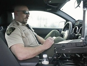 Marion County Sheriff's Deputy Ryan Postlewait fills out a citation during a traffic stop on Interstate 5 on Monday, March 7, 2011. Dep. Postlewait is a member of the traffic safety team, and had four arrests where the drivers was going over 100 miles per hour in February.  Credit: Statesman Journal