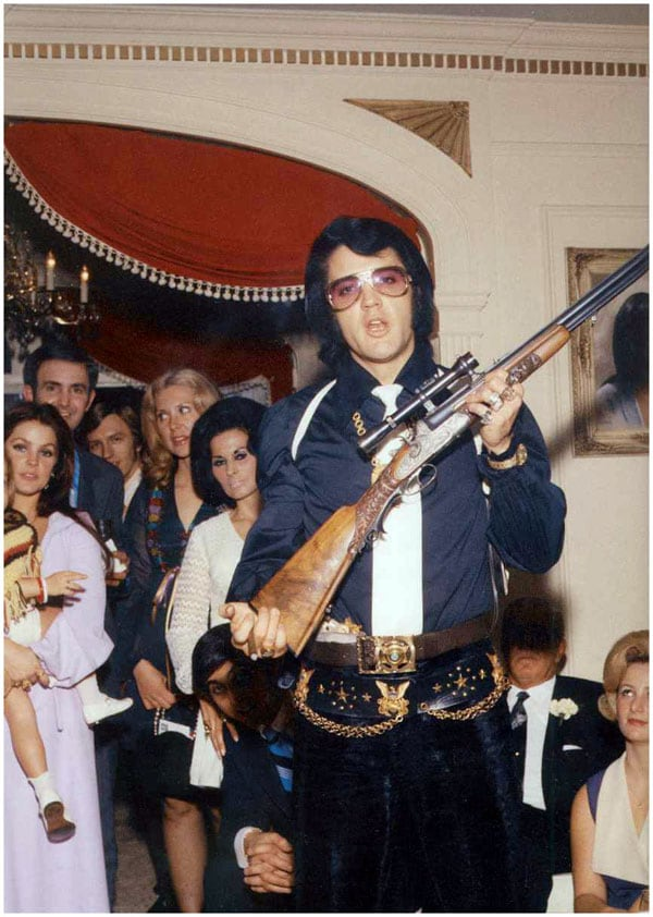 Elvis with rifle