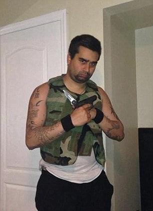 Dual wielding: Derek Medina in camo with knife and gun