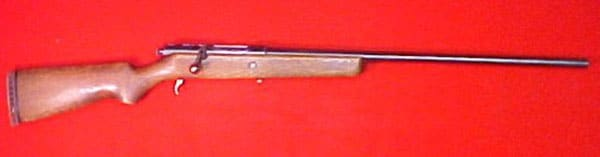 Mossberg Model 75 on red display cloth