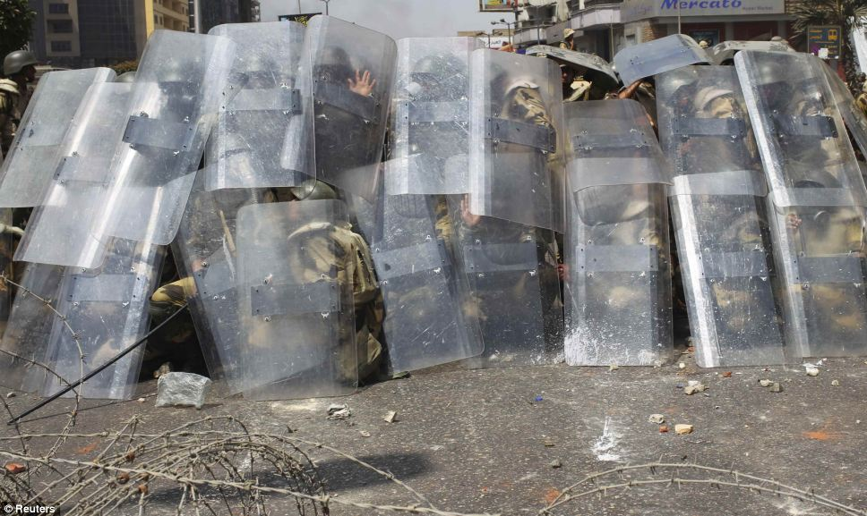 Police and military used riot shields to defend against the Morsi supporters, who hurled rocks and other objects at them.