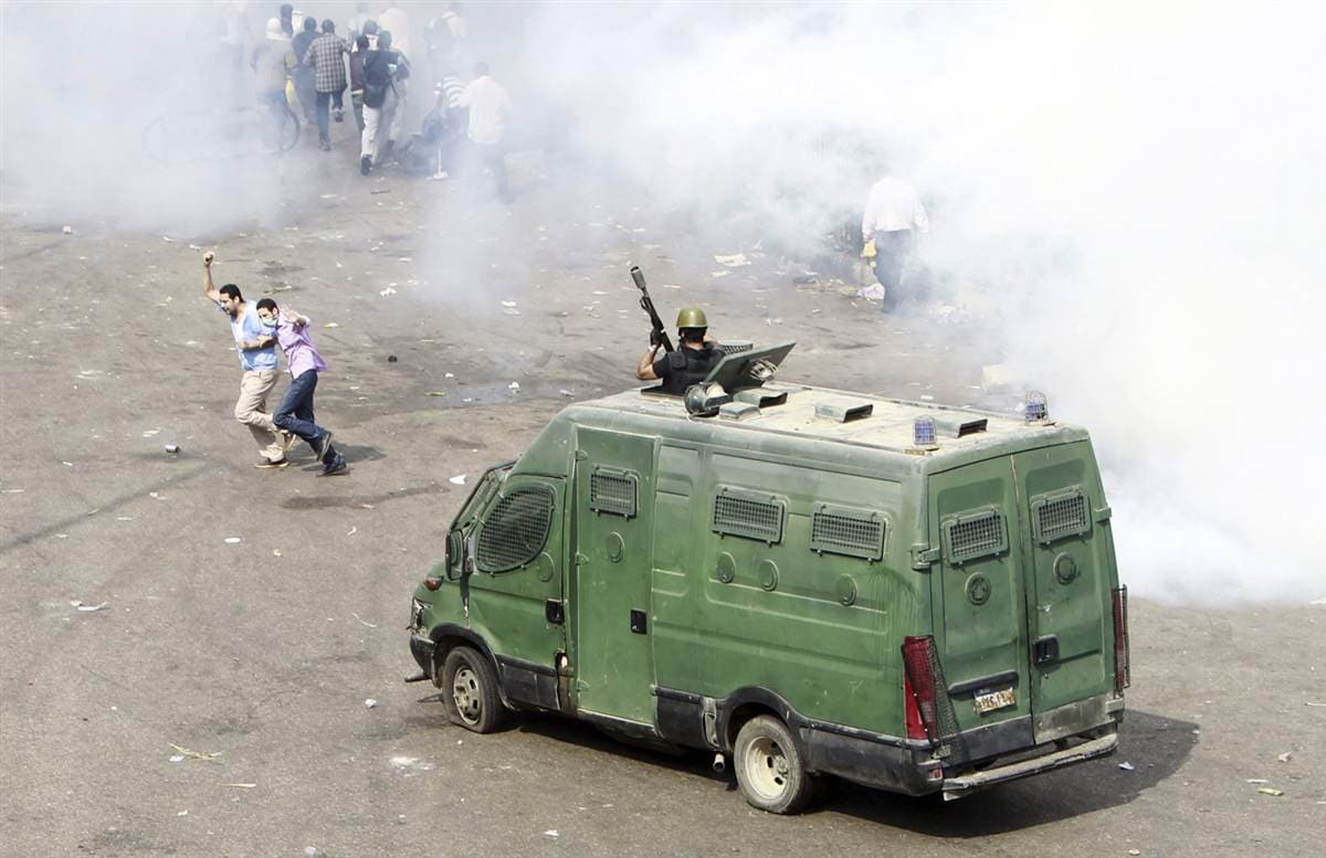 Police initially used less-than-lethal rubber bullets and tear gas to disperse the sit-in Morsi group.