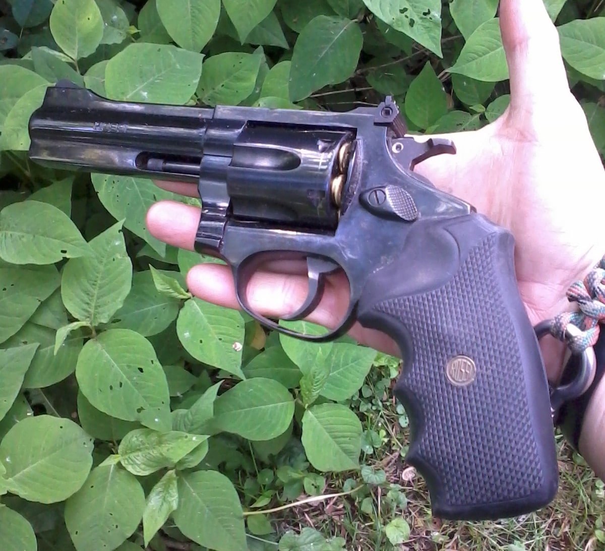 rossi revolver in hand outside