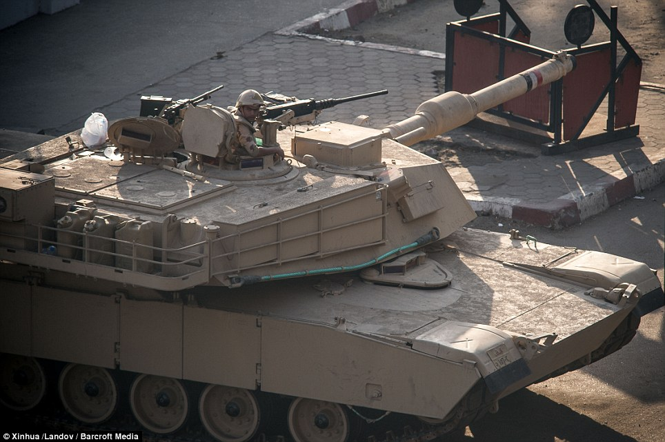 Soldier in Cairo kept guard in tanks and other armored vehicles.