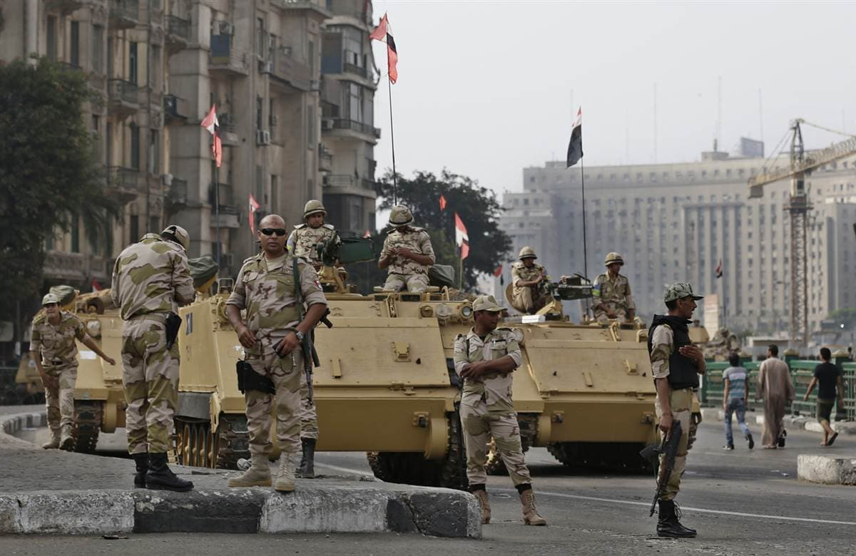 Soldiers guard the entrance to Tahrir Square in Cairo.