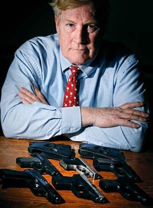 Jim Corley, an attorney in South Carolina, displays some of his handguns, including one that he used in 2009 to stop a holdup and kill a would-be robber. (Photo credit: NBC)