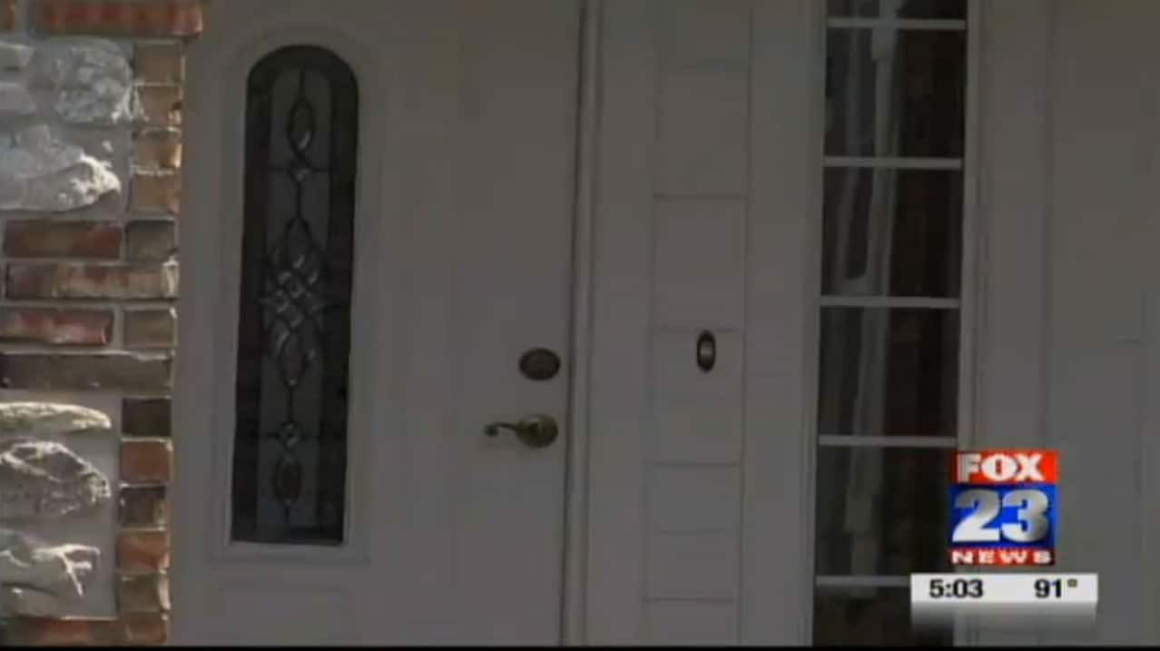 I guess I might be suspicious of a half-naked man holding a gun and knocking on my door too. (Photo credit: Fox 23)