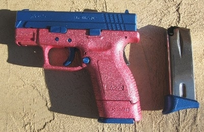 Springfield XD-9 with a Pink Sparkle frame and Electric Blue slide, mag bases and controls