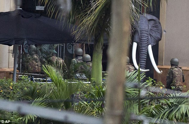 Troops can be seen making their way into the mall during the standoff. (Photo credit: Associated Press)