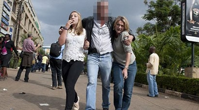 The off-duty SAS soldier is pictured walking two women to safety. (Photo credit: Bancroft Media)