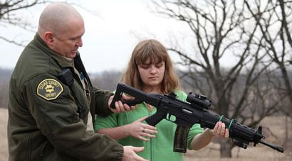 Sheriff Warren Wethington has been teaching his legally blind daughter, Bethany, how to use a firearm, as he believes that she should not be excluded from her Second Amendment rights simply because she is visually impaired. (Photo credit: Des Moines Register)