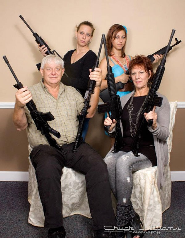 Colonel Nielsen with his family and federally licensed select fire weapons.