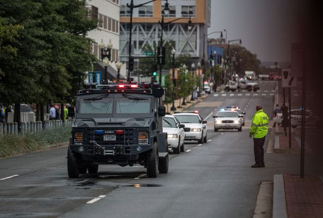 SWAT arrives after reports of an armed gunman. (Photo credit: Associated Press)