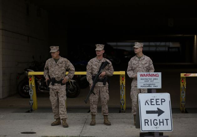 Armed soldiers stand guard outside the Washington Navy Yard. (Photo credit: The Washington Times)
