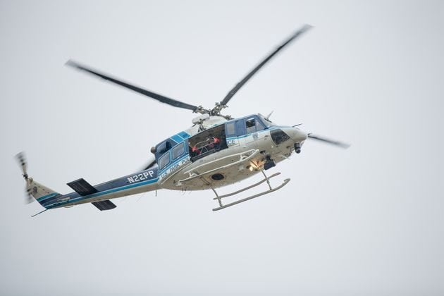 Helicopters circle the area searching for the gunman. (Photo credit: The Washington Times)