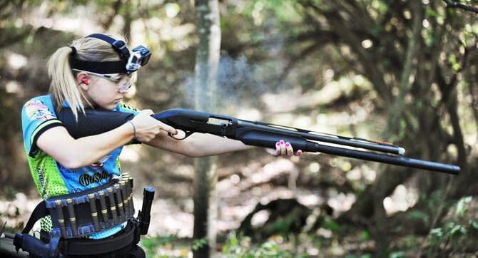 Katie admits that of all the guns she uses, the shotgun is her favorite. (Photo credit: News Tribune)