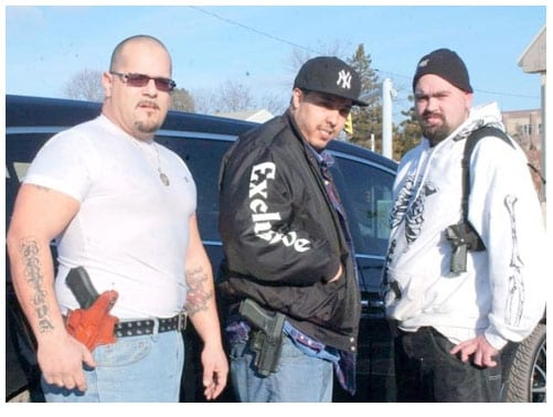 George Irizarry and two friends, all who routinely open carry in the Hazelton, Pennsylvania. (Photo credit: Citizen's Voice)